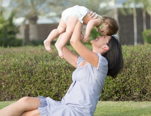 mother and baby playing in park